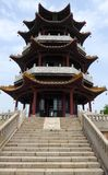 A pagoda with stone stairs in the front Royalty Free Stock Image