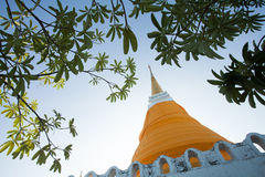 Pagoda or stupa of Thailand. With green leaves Stock Image
