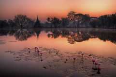 Pagoda in Sukhothai before sunset with lake reflection Royalty Free Stock Photo