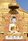 PAGODA TEMPLE CARVINGS GOLD. GOD CRAVING ON STONE royalty free stock photo