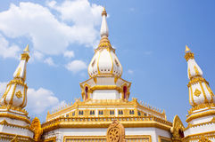 Pagoda in the temple of Thailand. One white pagoda in temple with blue sky background stock photography