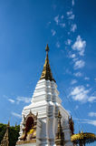 Pagoda in Thai traditional style against on blue sky Stock Photo