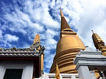Golden pagoda on the blue sky day Stock Photo