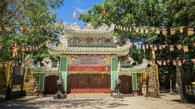 Pagoda at Trees Decorated with Banners under Sunlight Royalty Free Stock Photos