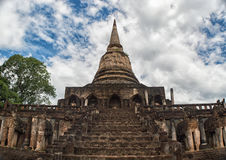 Pagoda of Wat Chang Lom, Sisatchanalai,Sukhothai,Thailand. With the ruins of elephant sculptures surrounding the base Stock Image
