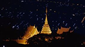Pagoda in Wat Phra That Doi Suthep at night  of Chiang Mai city background , Thailand