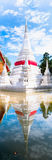 Pagoda. White pagoda have  red silk with reflection  at Kohkred , Nonthaburi ,Thailand Royalty Free Stock Image
