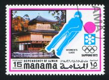 Pagoda and Women Luge. MANAMA - CIRCA 1972: stamp printed by Manama, shows Pagoda and Women Luge, circa 1972 Royalty Free Stock Images