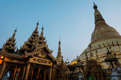 Pagoda and wood shrine in Shwedagon. Shrine and pagoda in Shwedagon both are gold color Royalty Free Stock Photography