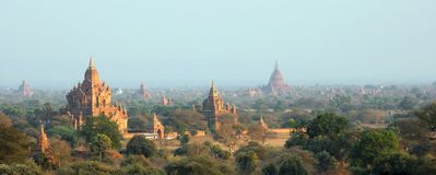Pagodas at Bagan. The pagodas of Bagan are lighting up in the mild evening light. Bagan is a historic city in Myanmar with over two thousend preserved pagodas Royalty Free Stock Image