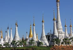 Pagodas at Inle lake. A field of white pagodas situated on an island in Inle lake, Myanmar. The sky is spotlessly blue Stock Photography