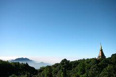 Pagodas mountains mist clouds and sky Royalty Free Stock Photography