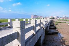 PagOldest bridge, bridge, cross-sea bridge, artificial cross-sea bridge, artificial bridge, bridge construction, bridge technology. Blue sky , white clouds,stone stock photography