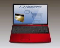 Pagos en comercio electrónico con el cuaderno rojo Foto de archivo libre de regalías