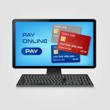 Pague o conceito em linha e em linha da compra - computador com os cartões de crédito na tela Foto de Stock