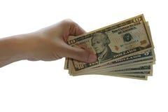 Pague o dólar americano, dinheiro do dólar do uso da mão no backgroun branco Fotografia de Stock