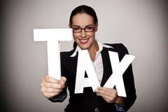 Pague su impuesto. Imagen de archivo