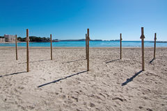Paguera spring beach. Spring beach, new parasol poles in sunshine and blue ocean, Mallorca, Spain stock images