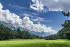 Pahalgam Golf Course with mountains in background, Jammu and Kashmir. Pahalgam Golf Course is a 18 hole course, surrounded by snow capped mountains, pine trees Stock Images