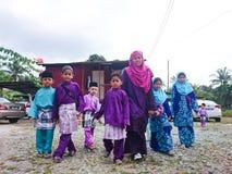 Malay children when Aidilfitri. PAHANG, MALAYSIA - Jun 13, 2017 : Malay children ready to visit a neighbour when Aidilfitri festive season. They dressed a Malay Royalty Free Stock Photos