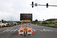 Pahoa, Hawaii, United States, June 5 2018: Because of a volcanic eruption of the volcano Kilauea closed road in Pahoa. The police check all vehicles for their Stock Photos