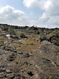 Pahoehoe Lava Rock Patterns Under Puffy White Clouds in the Sky. Big Island, Volcano, Hawaii Stock Photos