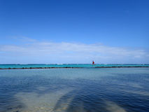 Pahonu Pond (Ancient Hawaiian Fishpond) with Sail boat in the di Stock Photo