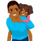 Pai afro-americano Daughter Piggyback Fotografia de Stock