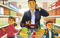 Pai com crianças em um supermercado Fotografia de Stock