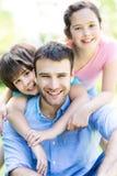 Pai com duas crianças Foto de Stock Royalty Free
