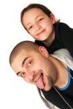 Pai com levantamento da filha Fotos de Stock Royalty Free