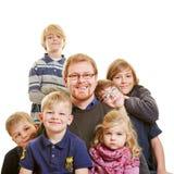 Pai com seis crianças Fotos de Stock Royalty Free