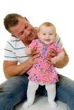 Pai e bebê de sorriso Fotos de Stock