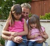 pai e crianças imagem de stock
