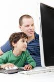 Pai e crianças com computador Imagem de Stock Royalty Free