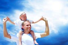Pai e filho alegres Imagens de Stock Royalty Free