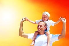 Pai e filho alegres Imagem de Stock Royalty Free