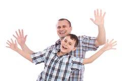 Pai e filho alegres Foto de Stock Royalty Free