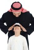Pai e filho muçulmanos árabes Fotografia de Stock