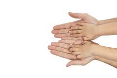Pai e filho que guardam as mãos no fundo branco Fotografia de Stock Royalty Free