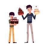 Pai e filho que guardam os bolos de aniversário, preparando-se para o partido Fotografia de Stock Royalty Free