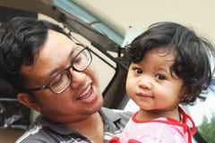 Pai e sua filha Imagens de Stock