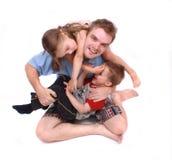 Pai e suas crianças bonitos Foto de Stock Royalty Free