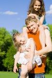 Pai novo com crianças fotografia de stock royalty free