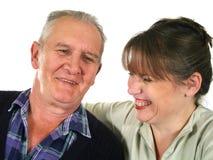 Pai que ri com filha fotografia de stock