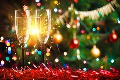 Paia dei vetri e della stella filante del champagne Fotografia Stock