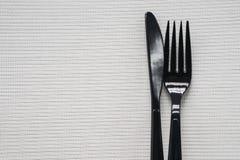 Paia della forcella e del coltello di plastica con fondo bianco Fotografia Stock Libera da Diritti