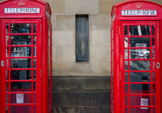 Paia delle cabine telefoniche rosse, Regno Unito Fotografia Stock
