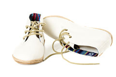 Paia delle scarpe di tela d'avanguardia isolate su bianco dal lato Fotografie Stock