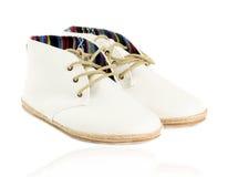 Paia delle scarpe di tela d'avanguardia isolate sul reflecti bianco di vista laterale Immagini Stock